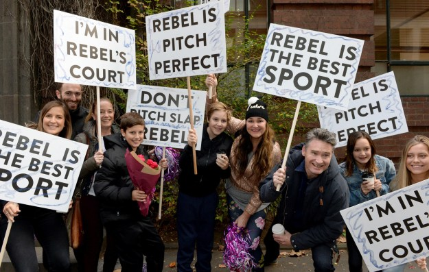 """Comedian Dave """"Hughesy"""" Hughes and a bunch of supporters showed up with signs to rally behind the actress."""