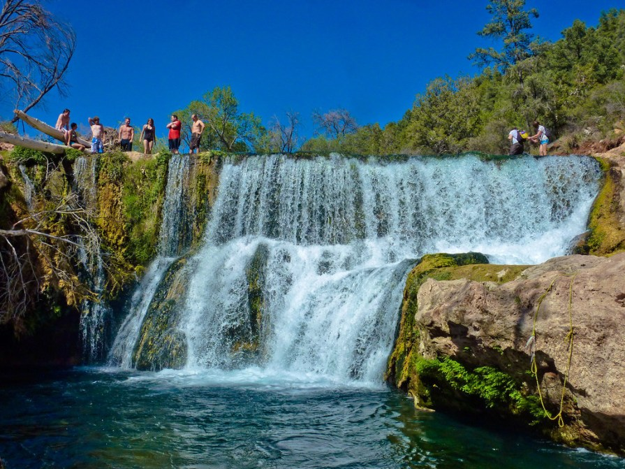 About 80 miles from Phoenix sits this oasis: a crystal blue swimming hole teeming with waterfalls. You'll need to reserve a permit to visit Fossil Creek, and you'll have to hike for a mile before reaching the swimming hole, but one visit and you'll see that it lives up to all the hype.