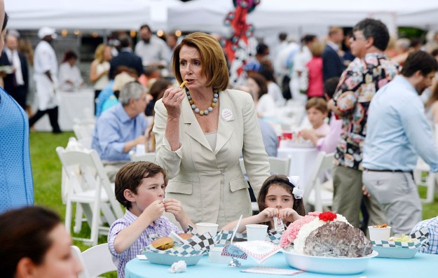 This #moment of Nancy Pelosi taking a bite of crunchy, fried goodness.