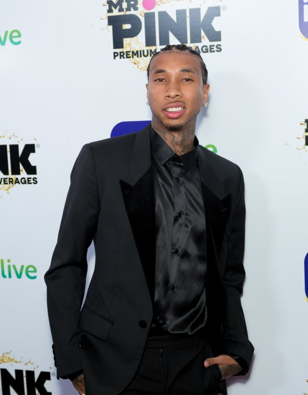 Then Kylie Jenner's ex-boyfriend Tyga also made an appearance dressed in a dapper all-black ensemble. He also happens to be the father of Blac Chyna's 4-year-old son King Cairo Stevenson.