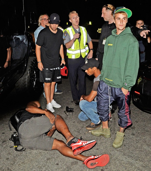 The singer had been at the Saban Theater in Beverly Hills for an event. As he tried to drive away afterwards, a number of photographers surrounded his vehicle. A video obtained by TMZ shows his car coming into contact with one man, who then fell to the ground.