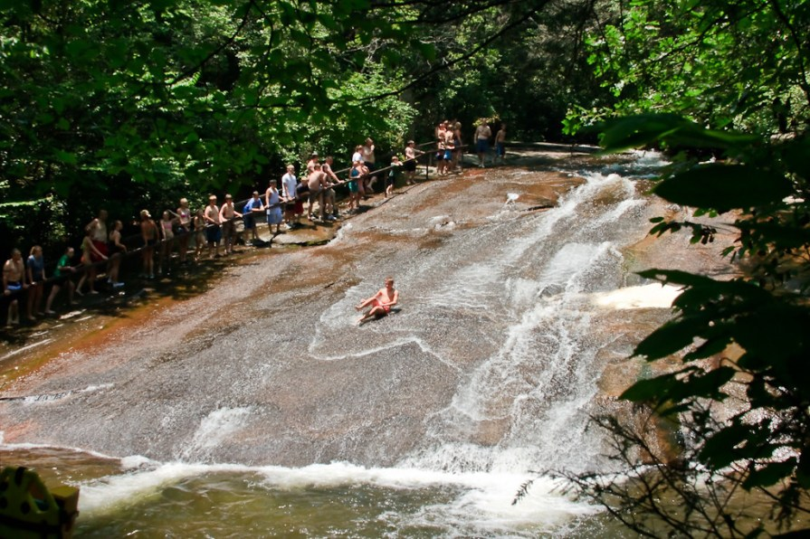 Is this the world's best natural water park? On any warm summer day, you'll find hundreds of people sliding down this 60-foot water slide in Pisgah National Forest.