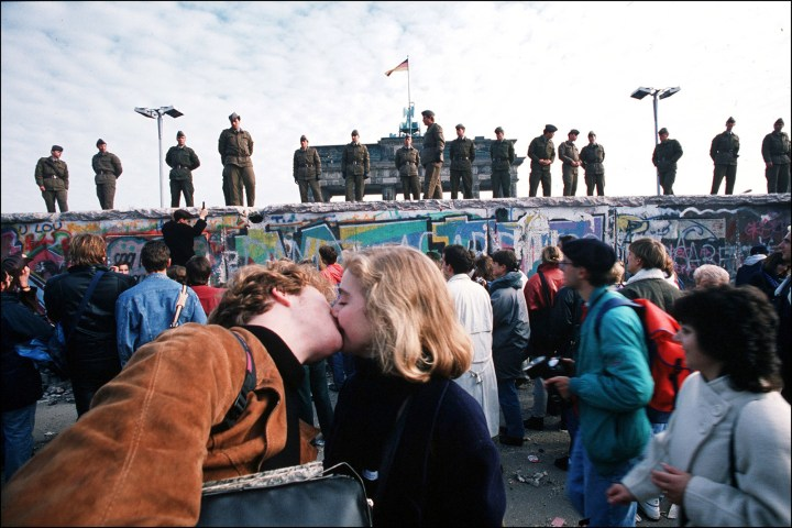 10. This young couple kissing before the fall of the Berlin Wall in 1989: