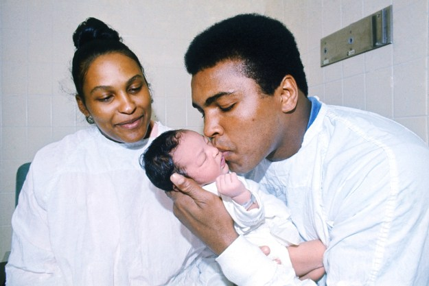 11. Muhammad Ali tenderly kissing newborn son Muhammad Ali Jr. while his his wife Belinda looks on in 1972: