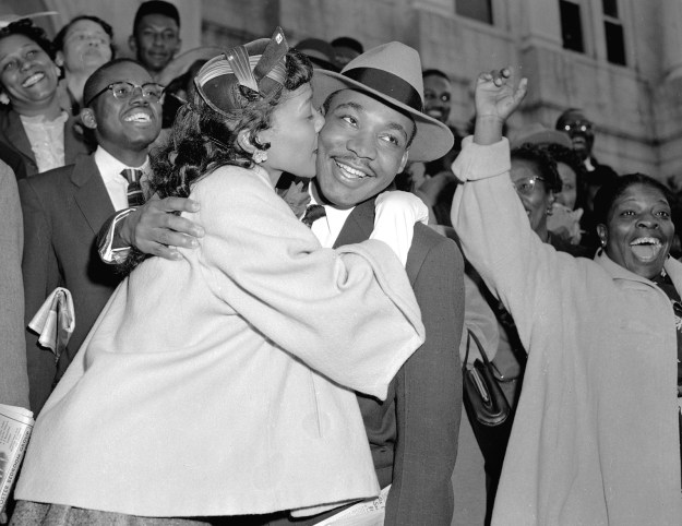 6. Coretta Scott King giving Martin Luther King Jr. a kiss of relief following his court appearance after the Montgomery bus boycott in 1956: