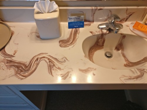 Whoever designed this kitchen sink that will never look clean: