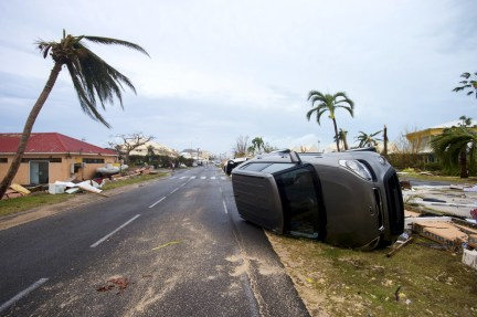 A car is turned onto its side from hurricane winds in Marigot on Wednesday.