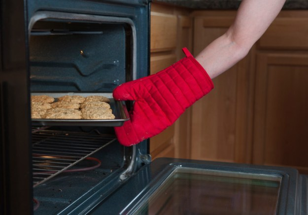 Never take something out of the oven using a wet towel or mitt.
