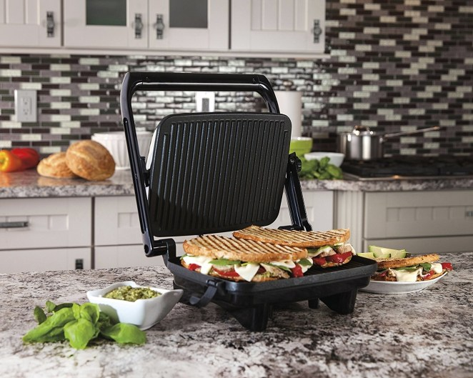 The cafe-style floating lid can press a sandwich of any thickness, so feel free to layer up! —Nancy A.Get it from Walmart for $24.94 or from Jet for $24.94.