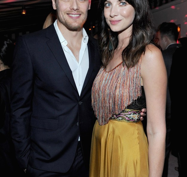Outlander's Sam Heughan and Caitriona Balfe smiled for the camera.