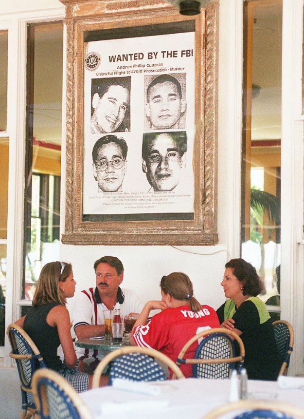 A family sat under a large wanted poster of Cunanan at the Edgewater Hotel in Miami Beach.
