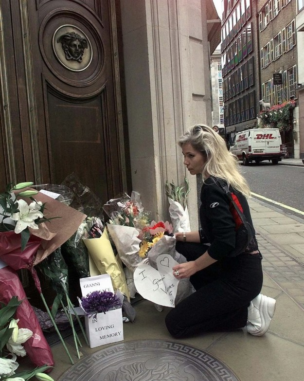 A well-wisher paused while placing flowers and a card in front of the entrance to the Versace headquarters in London.