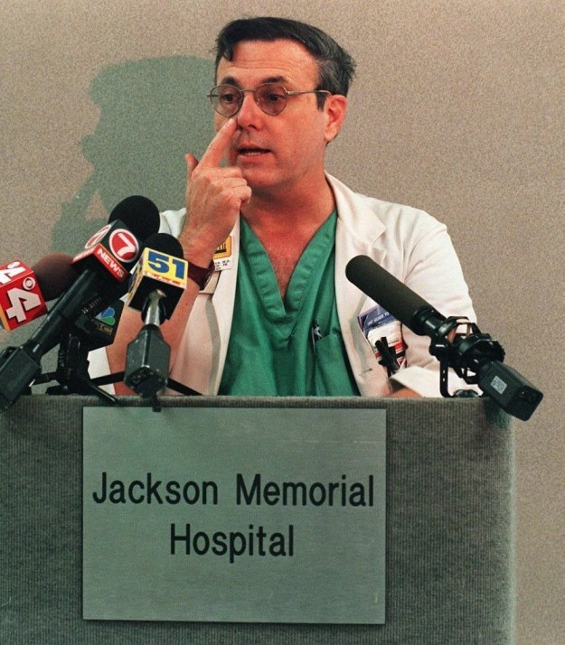 Dr. Phillip Villanueva, a neurosurgeon working at Jackson Memorial Hospital who treated Versace, showed the media the location of an exit bullet wound.