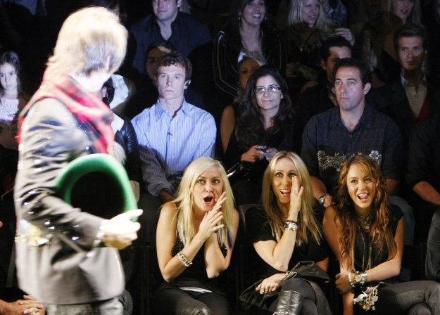 2008: Brandi, Tish, and Miley Cyrus cheered on her then-boyfriend Justin Gaston as he walked in a show.