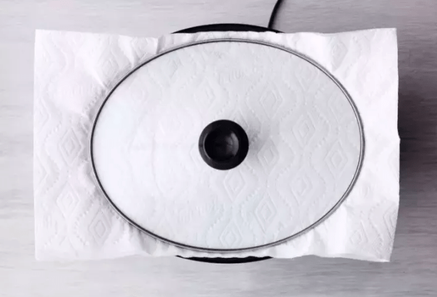 Line the lid of your slow cooker with a paper towel to absorb the condensation and promote browning.