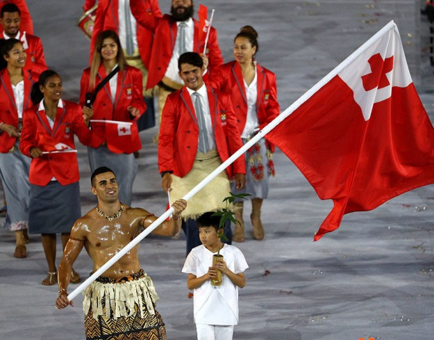 That would be their oiled-up flag-bearer, Pita Taufatofua.