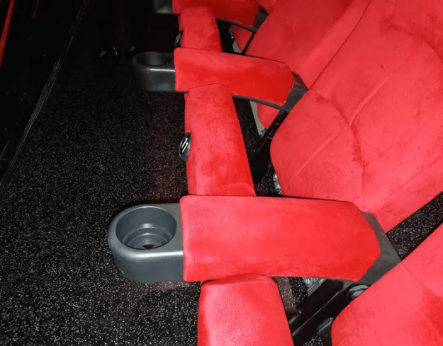 Movie theater seats have only had cupholders since the '80s.