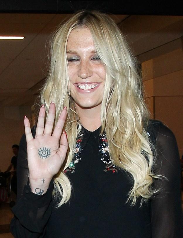 Kesha's palm tat.