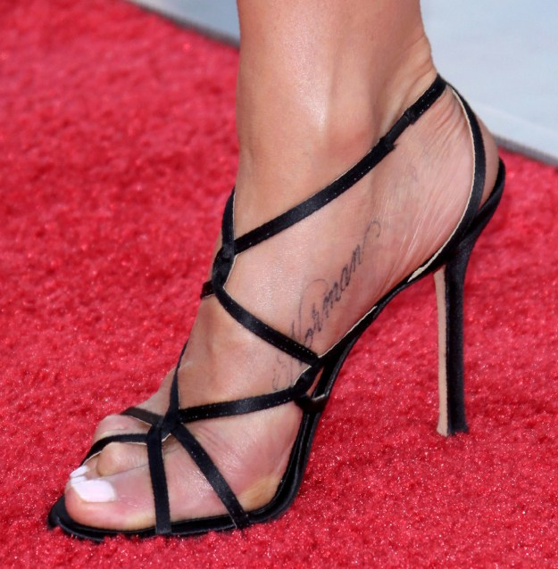 "Jenny Aniston's ""Norman"" side-foot tat."