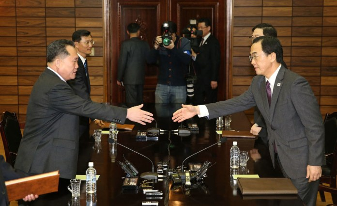 South Korean Unification Minister Cho Myoung-Gyon talks with North Korean delegation head Ri Son-Gwon during a meeting on Thursday, in the border village of Panmunjom, North Korea.