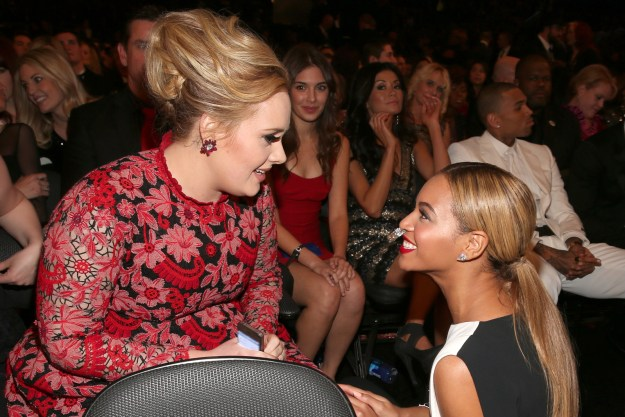 Adele and Beyoncé chit-chatted at the Grammys, and TBH we are all the woman in the red dress in the background excitedly watching every second of the conversation.