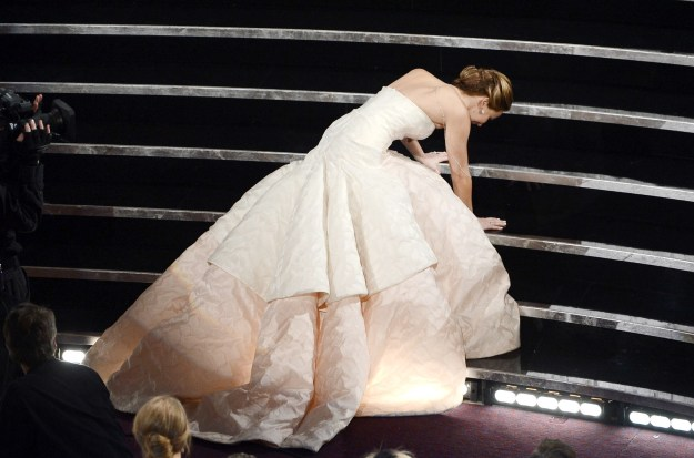J.Law took a tumble on her way to picking up her Oscar for Silver Linings Playbook.