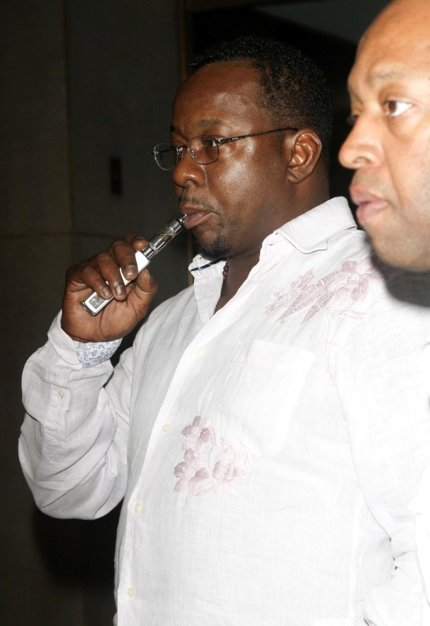 This is a picture of Bobby Brown vaping.