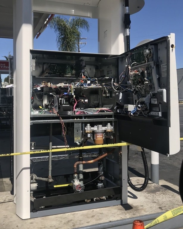 The inside of a gas pump that's full of mysterious wires, further fueling your curiosity.