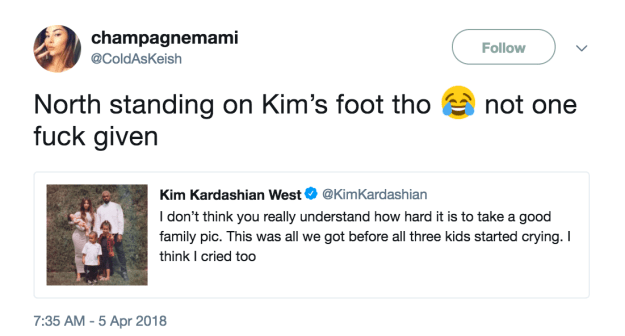 And eagle-eyed fans also noticed that Queen North West appears to be standing on Kim's foot.