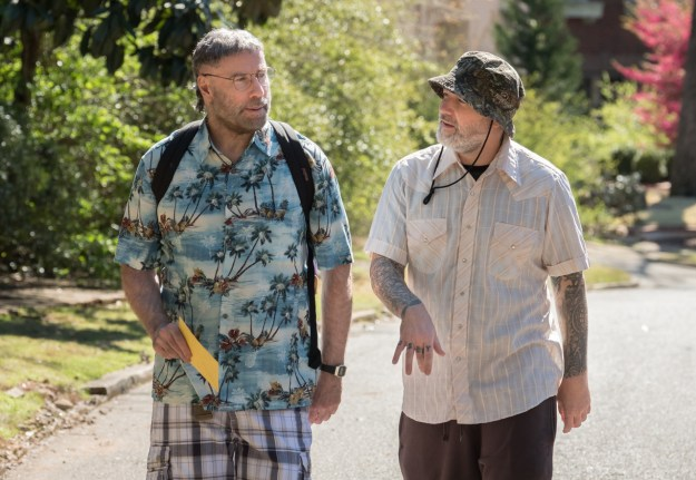 Why, my friends, is this picture of Fred Durst walking around with John Travolta (in a Hawaiian shirt) not on the front page of every newspaper in this country?