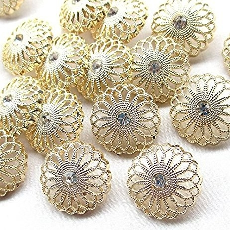 """Promising review: """"These are beautiful! I used them on some sleeve cuffs. They're stunning! They're about the size of a quarter. Just as pictured!"""" —CyndieGet a 20-pack from Amazon for $7.97 (available in six styles) or a similar product from Walmart for $3.96."""