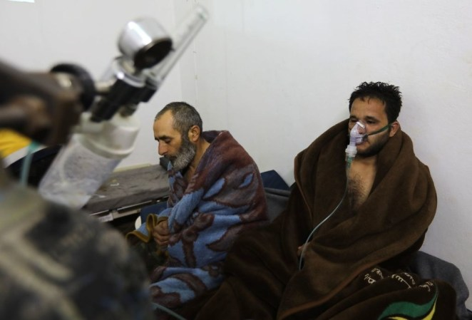 Syrians reportedly suffering from breathing difficulties Syrian regime air strikes on Saraqib, in Idlib province, in February.