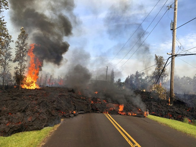 Lava slowly advances to Hookapu Street in Leilani Estates on May 5.