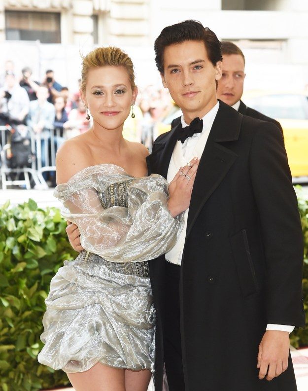 Lili arrived with her Riverdale co-star Cole Sprouse, and based off the hand-to-chest contact, it seems like these two are finally confirming their rumored relationship: