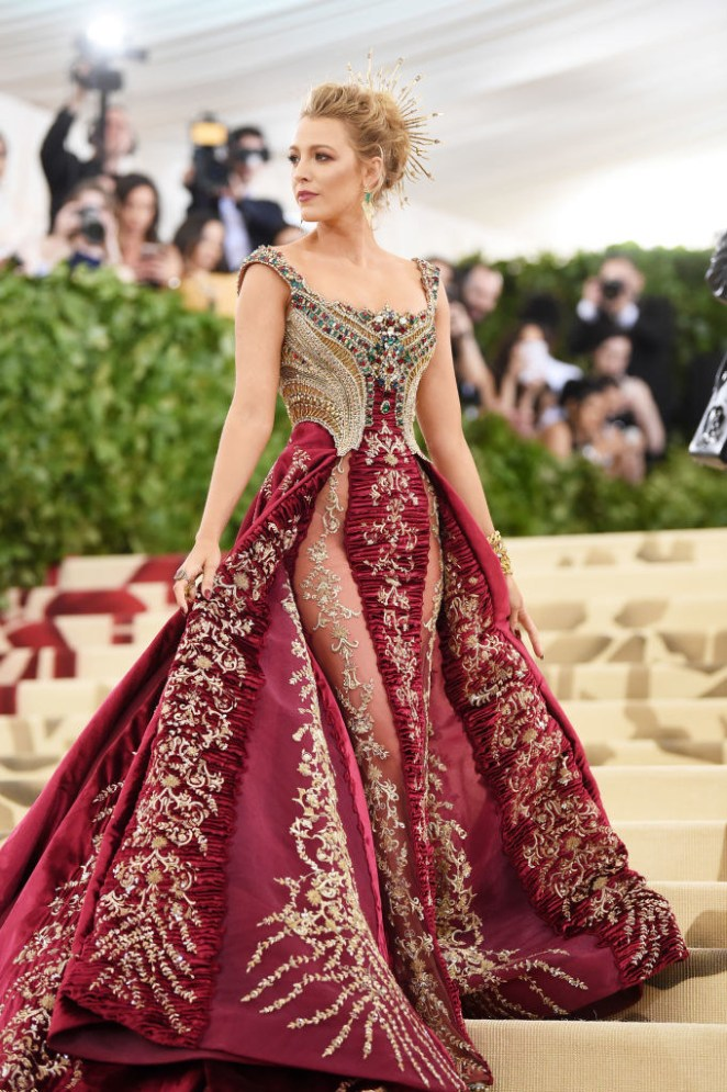 """""""Spliced with sheer panels on both sides and covered in so many beads that it took 600 hours to embroider the bodice alone..."""""""