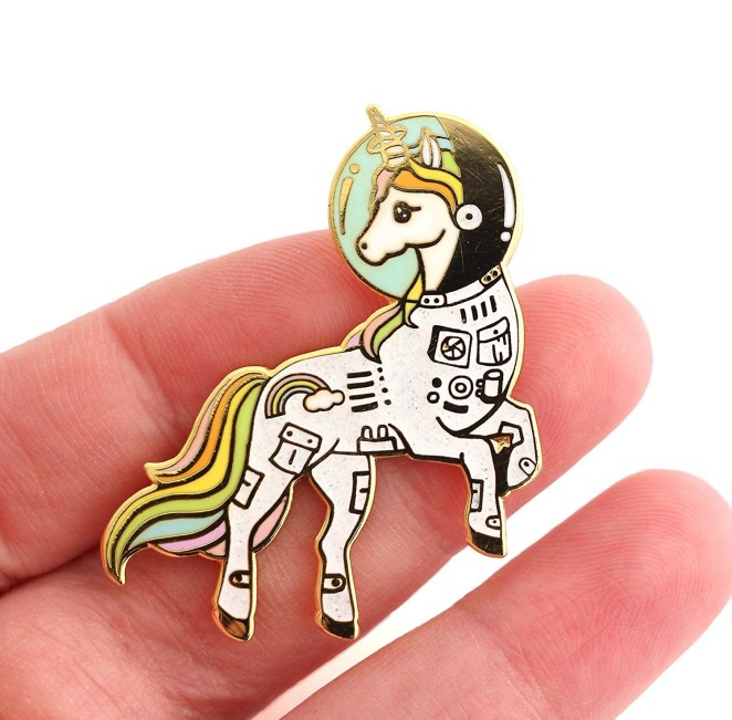 "Promising review: ""This pin is perfectly magical! It's wonderful quality and absolutely gorgeous in person! The space suit is actually sparkly, which was a nice extra!"" —Brooke_KathleenGet it from Amazon for $9.20."