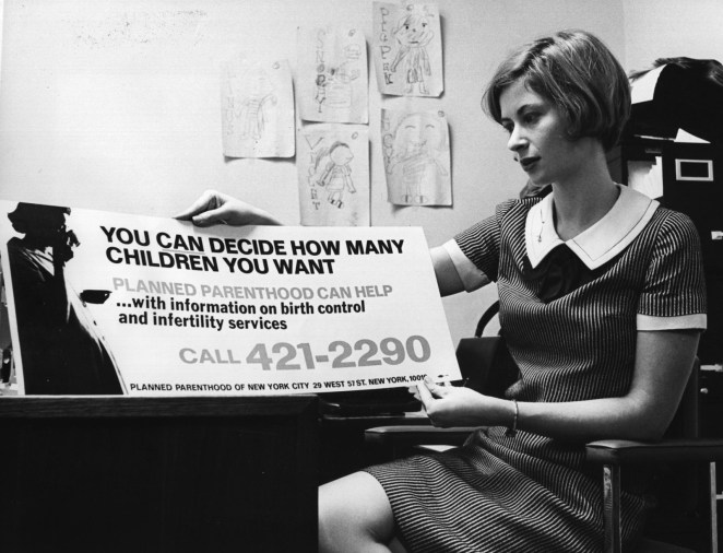 Marcia Goldstein, the publicity director of Planned Parenthood, shows a sign advertising birth control that would soon be displayed on New York buses, on Dec. 14, 1967.