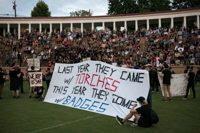 Activists rally at Lambeth Field on the campus of The University of Virginia.