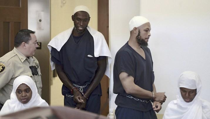 From left: Hujrah Wahhaj, Lucas Morton, Siraj Wahhaj, and Subbannah Wahhaj enter District Court in Taos, New Mexico.