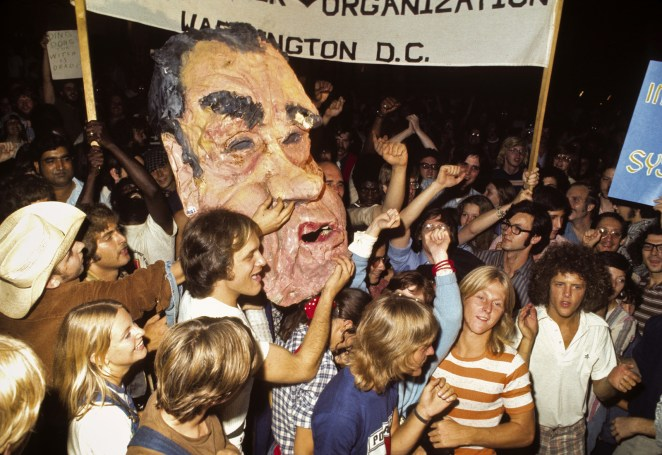 People gather and celebrate in front of the White House on the evening of Nixon's resignation speech.