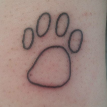 """If you look at this tattoo, it looks like any paw print, but it's my cat's actual paw. He was my fur baby — he gave me kisses when I got home and he loved to sit on the counter beside me while I cooked.""—chelseap41bbad0ab"