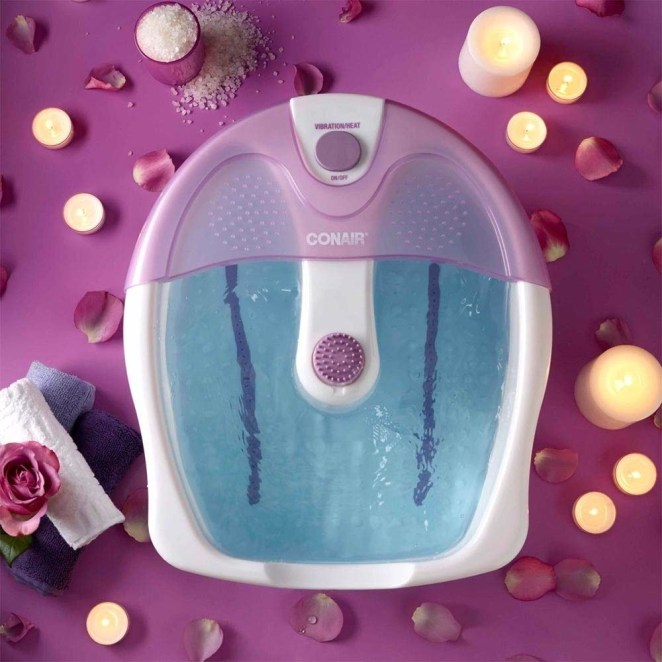 """Promising review: """"I bought this foot spa after experiencing nerve paralysis in my foot from a blood clot removal procedure. This left my foot semi-swollen and in definite need a pedicure. I wasn't allowed to get one for a few months, however, so I purchased the Conair Foot Spa. I did my research, checked costumer reviews and found that this one was the best product within the price range and it did not disappoint. If you're looking for the absolute best product then you're not going to find it at this low of a price, but if you're looking for a good foot spa that does the job, then you've come to the right place. It stays mildly heated if you fill it with warm water and it also has a small, constant vibration. This foot spa is a great way to pamper yourself at home and on a budget!"""" —AshleyGet it from Amazon for $21.99+ (available in two colors)."""