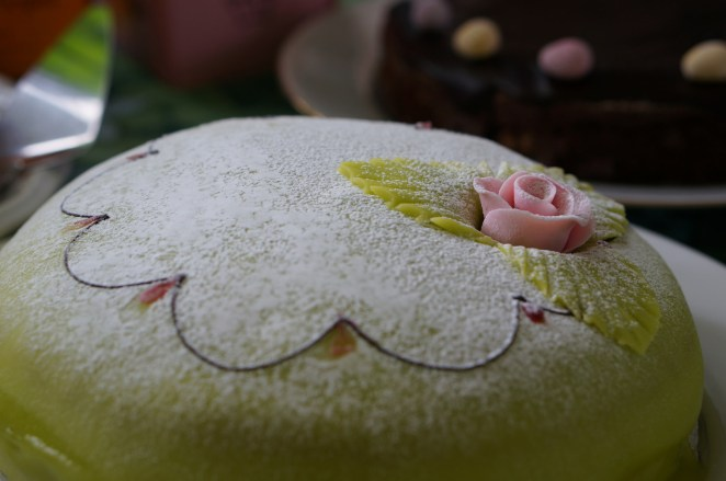 """In Sweden we have Prinsesstårta (princess cake). It's 2-3 layers with spongecake with vanilla cream, and jam & whipped cream in-between. Then it's green marzipan and a marzipan rose on top. If you want to you can top it of with powdered sugar."" —redbike04"