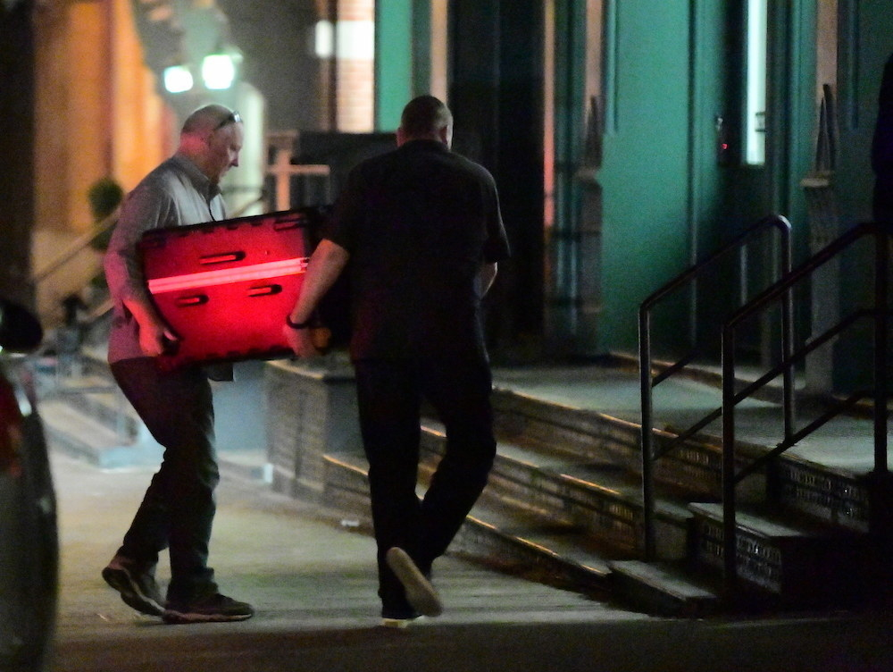 Taylor Swift allegedly being carried to her apartment in a suitcase at night