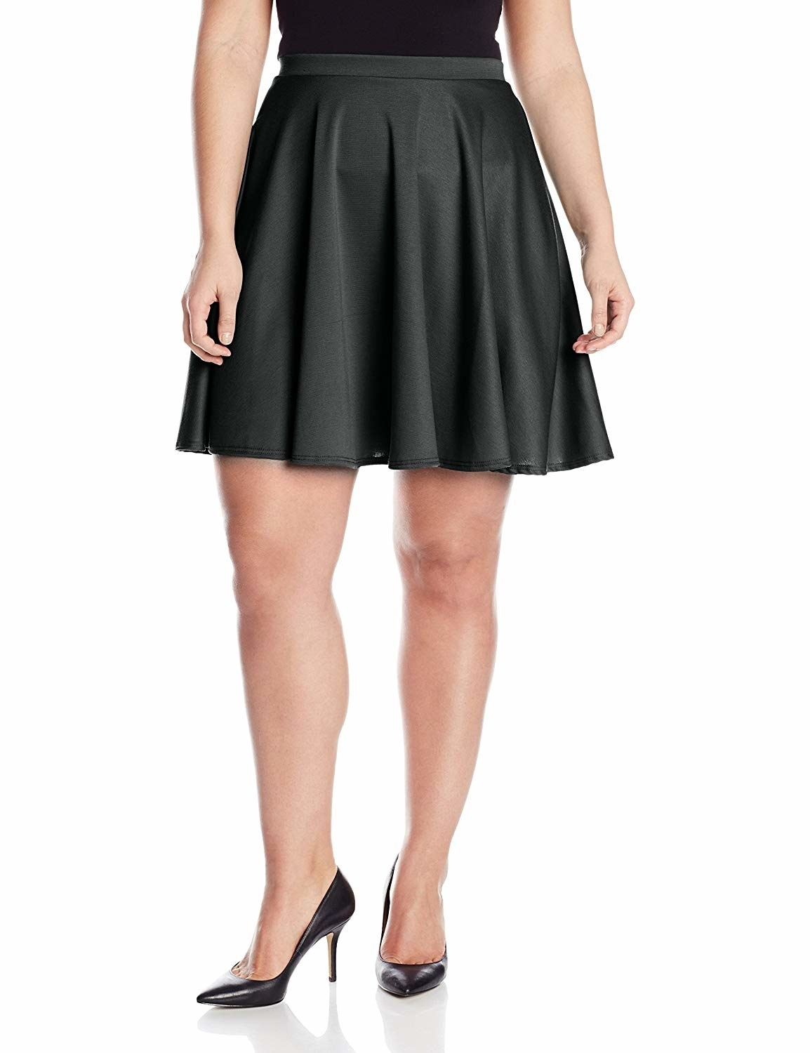 """Promising review: """"I ordered both the black and the blue skirts in 2X and they are now staples in my wardrobe. I love that this skater skirt is slightly longer than most I order. Now I don't have to worry about my butt showing! This skirt is great to wear to the office with a nice blouse, casually with a cute tank top, and even to parties or going out with more fun tops. There's nothing not to like about it."""" —Reyna VillaGet it from Amazon for .99+ (available in sizes 1X-3X and in two colors)."""