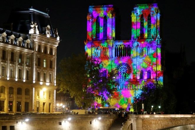 "A monument light and sound show, named ""Dame de Coeur"" by stage director Bruno Seillier, is projected on the facade of the Notre Dame Cathedral in October 2018."