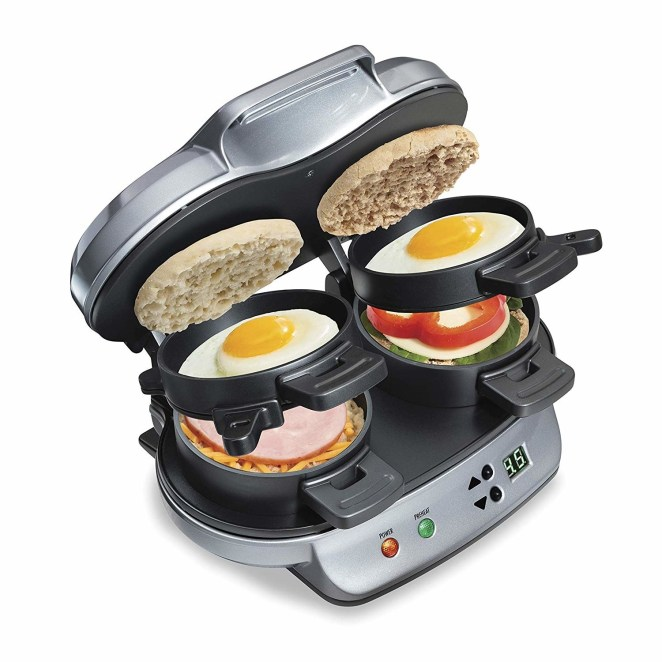 """Promising review: """"Worth it! I did not want another weird specialty kitchen appliances that would be used a little and then take up cabinet space. After over a month of indecision I finally bought it. It has been great for the entire family. It's about the size of a toaster and stores easily. It only takes a few minutes and it's really easy to clean up. We even prep for the week by putting one egg each in a 1 cup container with any veggies we want. Then each morning we pull out the food, pour it in the sandwich maker, set the timer and walk away. Less than minutes later we have a delicious perfectly cooked breakfast."""" —Amazon CustomerGet it on Amazon for $32.48."""