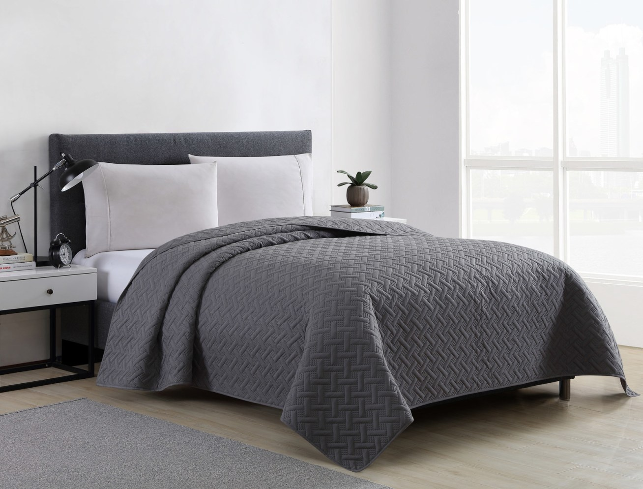 "Promising review: ""I love this quilt! It is just the right weight to keep us warm without feeling too hot and it is soft and comfortable. It washes and dries very easily. Our two basset hounds sleep on our bed with us; they shed and drool, so I wash the quilt every week. The dark gray is a true gray."" —notawahooPrice: .99+ (available in two sizes)"