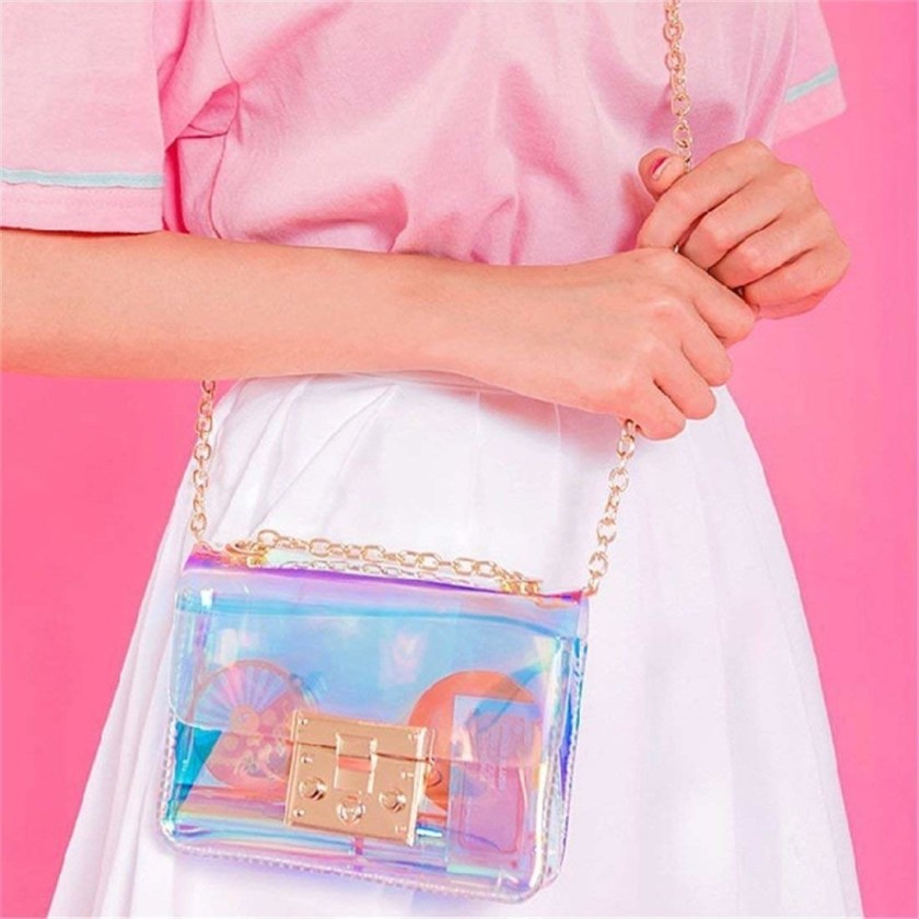 1a4cde506c63 An iridescent cross-body purse for some truly ~sweet~ arm candy you ll  never want to take off.