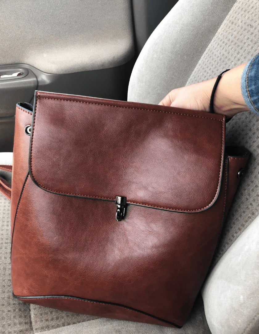 98617daec083 A faux-leather backpack you ll want to tote around on all your worldly  adventures. It  looks  like you dropped some serious cash for it — and we  won t say ...